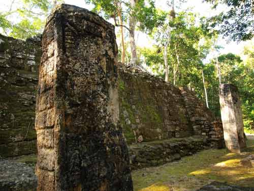 Carved stelae and stone wall at the ancient Mayan ruins of Calakmul