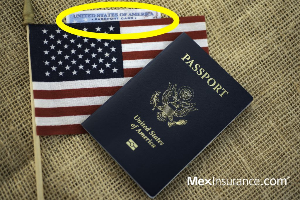 Passport card of USA covered by American Flag next to US international passport on burlap surface.