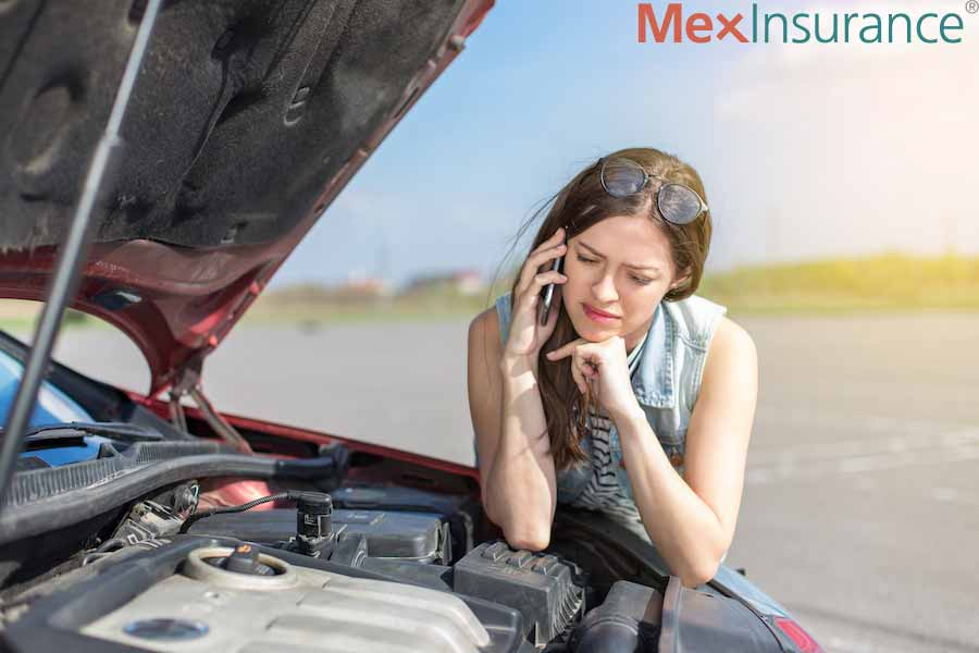 Woman standed on the road in Mexico calling Roadside Assistance