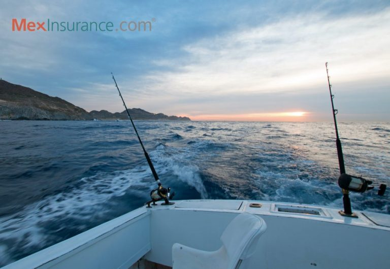 Sunrise view of fishing rod on charter fishing boat on the Pacific side of Cabo San Lucas in Baja California Mexico BCS